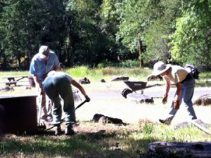 Volunteers clear camp sites